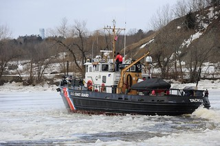 BOSTON - Coast Guard Tackle's crew breaks ice along the Penobscott River in Bangor, Maine, Feb. 21, 2013. The crew regularly break ice along Maine's rivers to keep the waterway open for commercial traffic and to prevent flooding. U.S. Coast Guard photo by Petty Officer 2nd Class Rob Simpson.