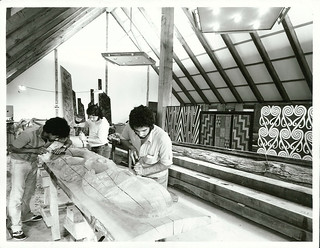Carvers at work on Poupou inside new Meeting House at the Orakei Marae, Auckland