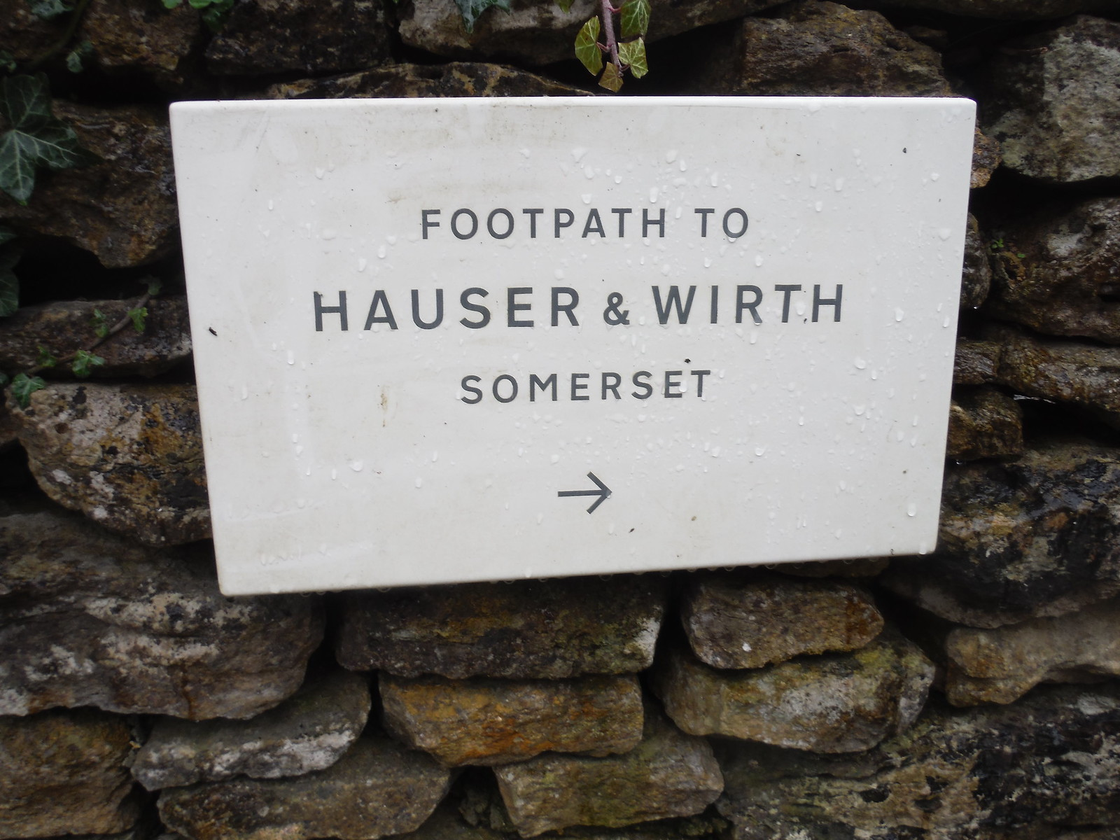 Footpath Sign SWC Walk 284 Bruton Circular (via Hauser & Wirth Somerset) or from Castle Cary