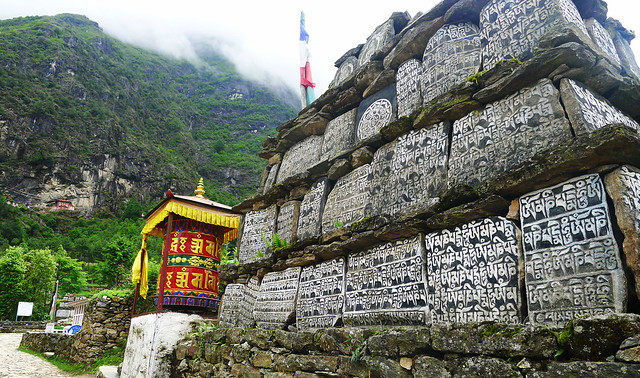 Buddhist Mani stones and prayer wheels
