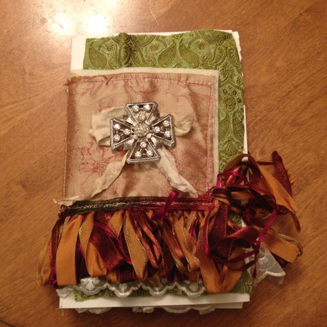 The journal I made this weekend. More photos to follow. It isn't finished but it will be Victorian Christmas themed.