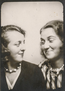 Two women smiling at each other in the photo booth