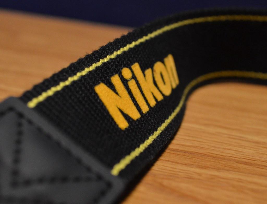 Yellow Nikon Logo