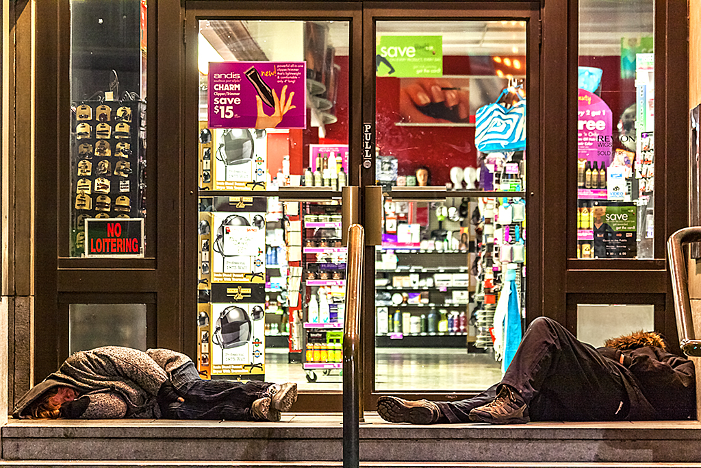 Two-sleepers-in-front-of-drug-store-on-4-4-13--Pittsburgh