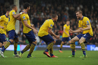 Lukas Podolski celebrates scoring his 1st goal