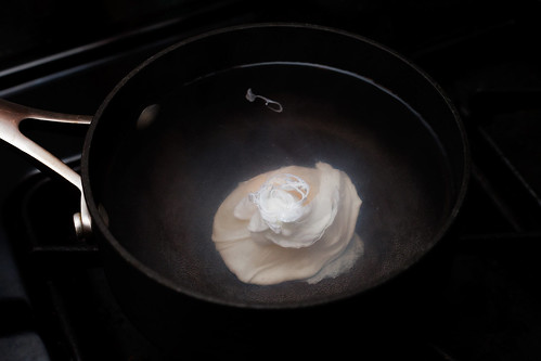 Poaching Egg floating in hot water