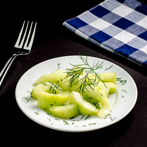 Sautéed Cucumbers on plate with dill garnish