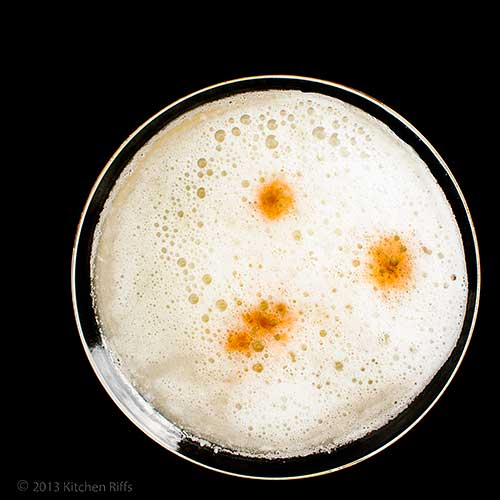 Pisco Sour Cocktail with Angostura Bitters garnish, overhead view