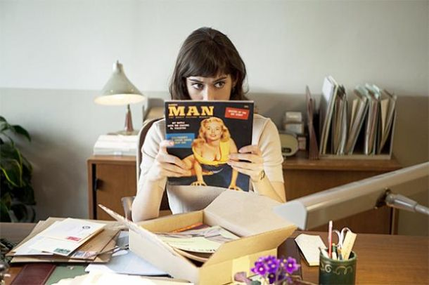 Virginia Johnson looking confused while reading a magazine called MAN