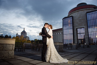 Bride and groom on balcony of St Paul History Center at night