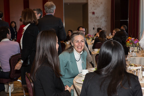 Professor Carol Osler interacts with students at the awards dinner