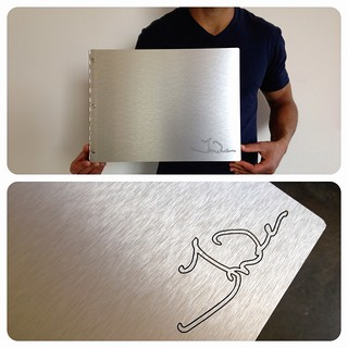 Custom brushed silver graphic design portfolio book with engraving treatment