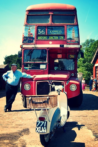 A red London Bus and a 1960s Scooter by davekpcv