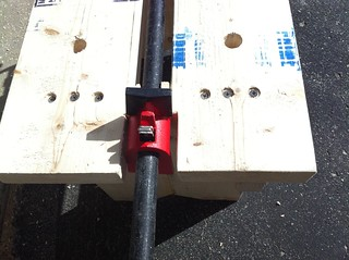 Pipe clamp and bench dog holes