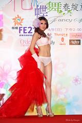 gown(0.0), quinceaã±era(0.0), prom(0.0), dress(0.0), model(1.0), abdomen(1.0), red carpet(1.0), leg(1.0), photo shoot(1.0), pink(1.0), flooring(1.0), adult(1.0),