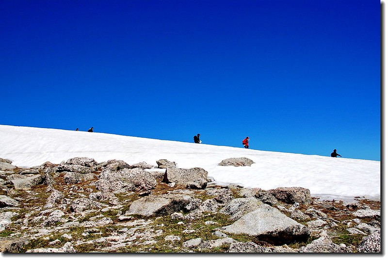 Hikers just back down from the top through the snowfield 5