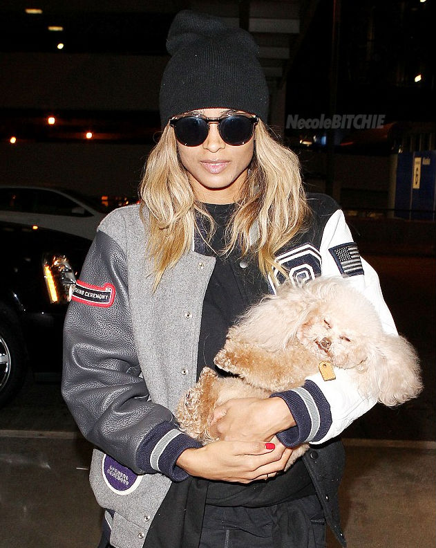 Ciara-arrives-to-the-airport-with-a-sleeping-Tyson