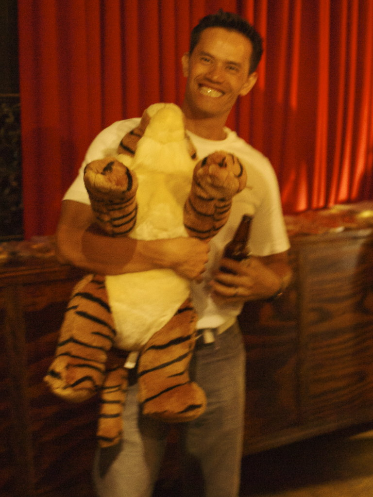 man with stuffed tiger