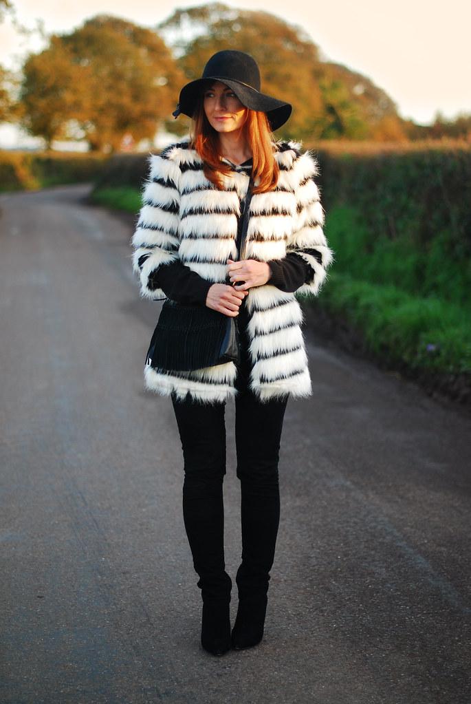 Black & white striped fur coat, black skinnies