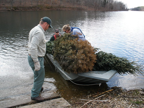 Tell City Ranger District employees prepare to install recycled fish habitat in an Indiana lake. (U.S. Forest Service)