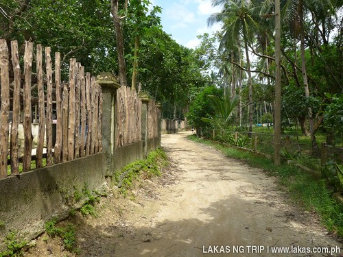 The pathway beside the cemetery to Gawad Kalinga Lodge & Restaurant in El Nido, Palawan, Philippines