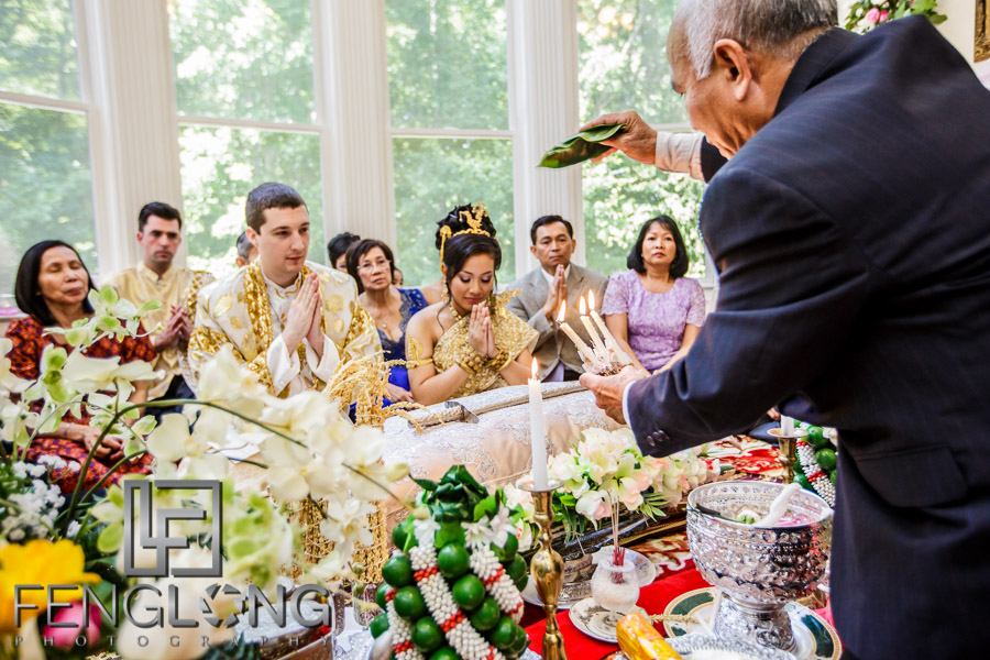 Elder blesses the couple during Cambodian wedding ceremony in Atlanta
