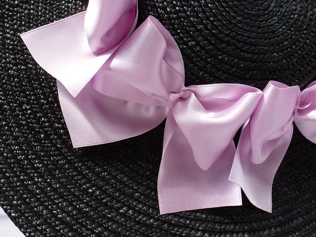 black straw hat trimmed with lavender silk satin ribbon bows