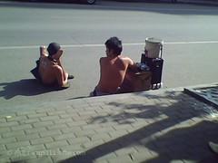 这是在南昌胜利路用手机(相机没带)拍到的一个场景,两个残疾者,他们为来往的人们唱着各种风格的歌,以...
