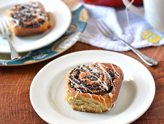 Two white plates with cinnamon rolls