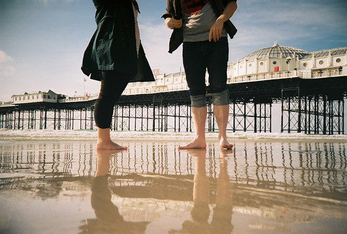 Low Down on Brighton Beach With Paddlers and Pier