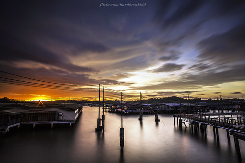 longexposure bridge blue sunset house water yellow clouds canon landscape boats eos skies nd 20mm brunei manfrotto nd400 veniceoftheeast watervillage bruneiriver kgayer 5dmkii sungaikebun