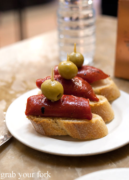 Roasted red peppers with olives on bread at El Xampanyet, Barcelona
