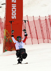 Josh Dueck crosses the finish line after his golden run in Sochi, RUS
