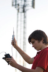 Student holding electrosmog in the air outside