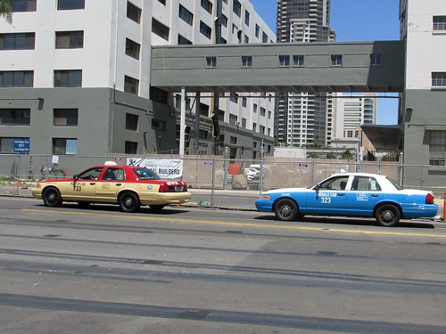 Two local taxi cabs pass by near the harbor.  San Diego California.  June 2013. by Eddie from Chicago