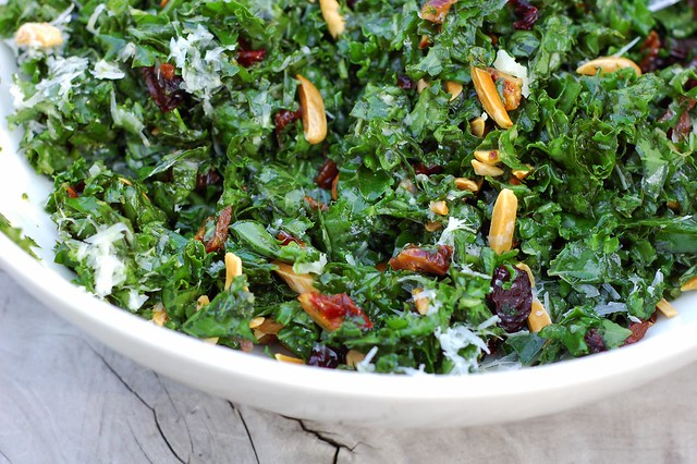Massaged kale salad with homemade dried cherries, toasted almonds and Parmesan cheese by Eve Fox, the Garden of Eating blog, copyright 2013