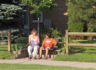 public bench in front yard (by: David Marcucci, from How to Design our World for Happiness)