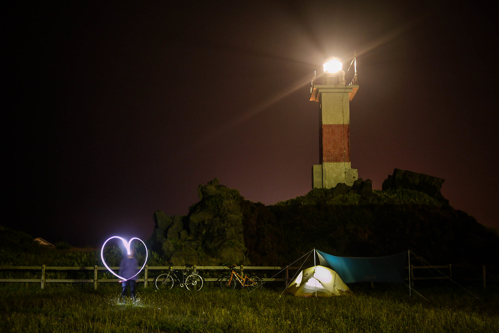 Lighthouse overlooking the Kutsugata-misaki Park Campground, at night, on Rishiri Island, Japan