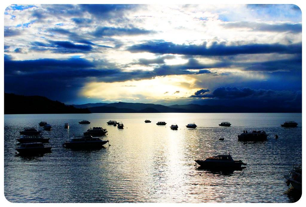 lake titicaca with boats copacabana bolivia