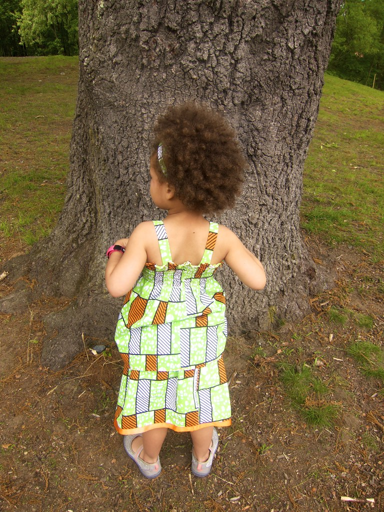 Matching wax print cousins outfits: Made by Rae Baby Sunsuit as top, Oliver + S Lazy Days skirt