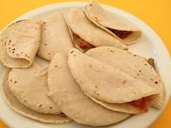 breakfast(0.0), pupusa(0.0), baked goods(0.0), quesadilla(0.0), naan(0.0), snack food(0.0), meal(1.0), bread(1.0), flatbread(1.0), tortilla(1.0), produce(1.0), food(1.0), piadina(1.0), dish(1.0), roti(1.0), cuisine(1.0), chapati(1.0),
