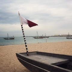Dark clouds came over us while we were at Souq Wakra... #Qatar #wakra #dhow #flag #beach #boats #cloudy