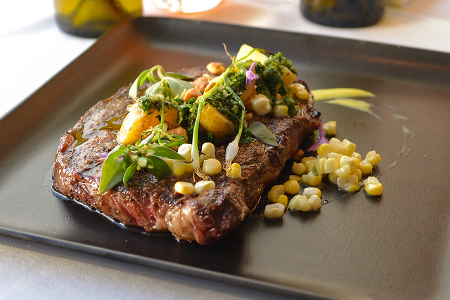 28 Day Dry Aged Ribeye, Roasted Chino Farms new potatoes, hazelnuts, grilled spring onions, chimichurri, Chino Farms corn
