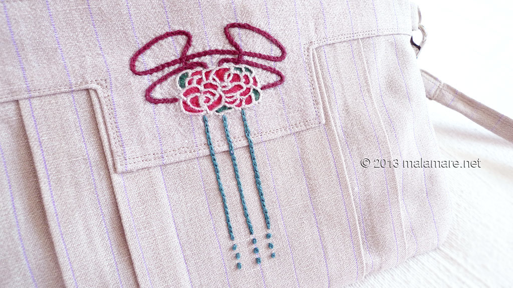 Art Deco inspired linen clutch bag with hand embroidery