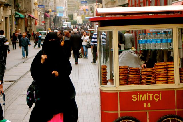 Woman in Burqa and Pretzel Vendor