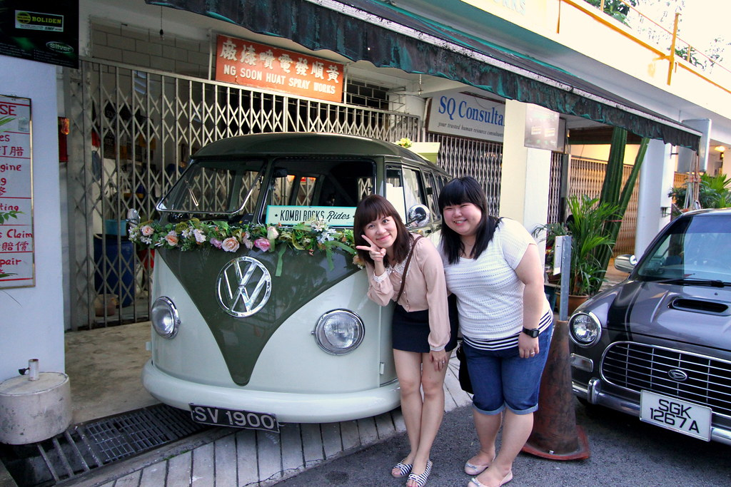 Maureen and friend taking picture Kombi Rocks Shop Front with vw kombi van