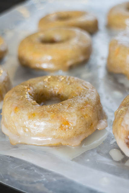 Glazed Carrot Cake Donuts taste just like cake! Recipe uses shredded fresh carrots, perfect for garden season.  Recipe make 1 dozen donuts.
