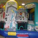 The kids will have plenty to keep themselves entertained with this unique inflatable moonwalk rental. They can bounce, play basketball, and slide all in one.
