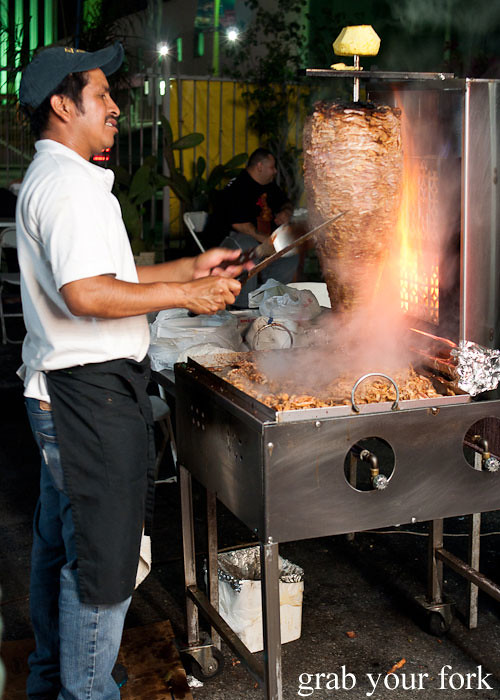 al pastor spit roast pork at el flamin taco truck in little korea, los angeles
