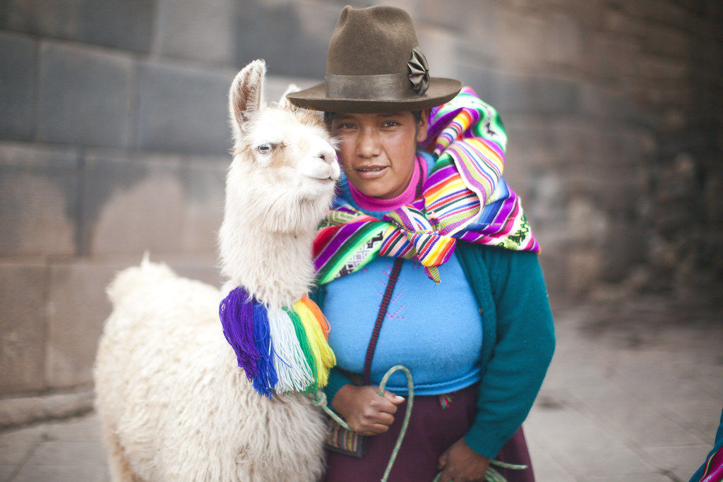 traditional Inca women with llamas in Cusco, Peru